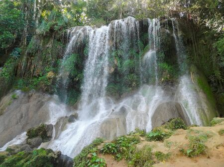 rock formation: rock formation with waterfall in Cuba, a island in the caribbean sea