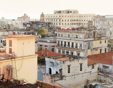 urbanized: aerial view of Havana, the capital city of Cuba at evening time