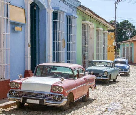 urbanized: classic cars seen in Cuba in sunny urban ambiance