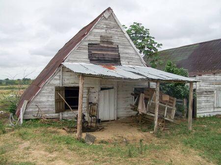 rundown: rural farming scenery including a rundown trailer seen in Cuba