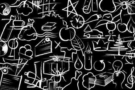 commercialization: lots of white crayon painted symbols on dark board Stock Photo