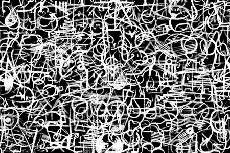 graffito: lots of white crayon painted symbols on dark board Stock Photo