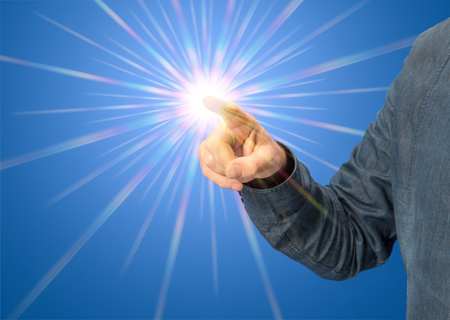 starlight: pointing male hand with starlight in blue back Stock Photo