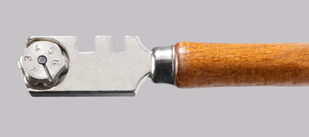 glasscutter: detail of a glass cutter in light grey back Stock Photo