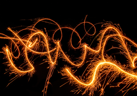 wavily: swinging, sparkling and glowing fireworks in dark back