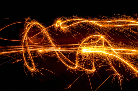 swinging, sparkling and glowing fireworks in dark back