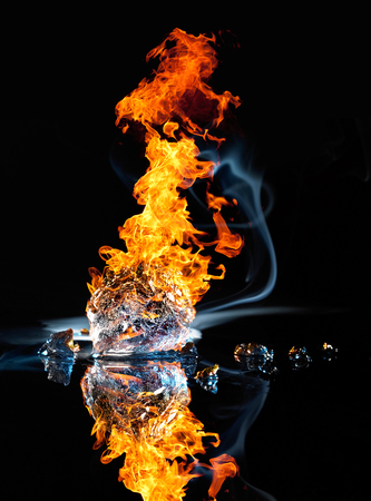 no fires: studio photography of a burning ice crystal and smoke in black reflective back
