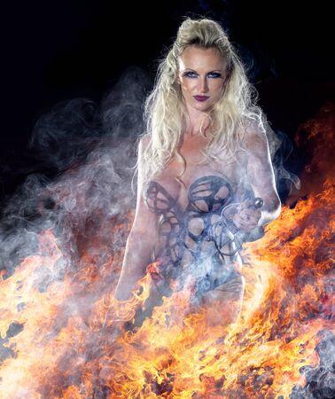 venganza: ángel vengador en el ambiente oscuro de fuego