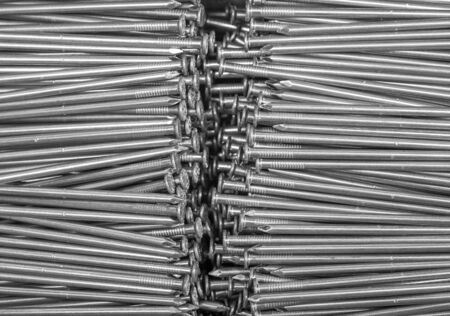 wire pin: full frame background showing lots of metallic nails Stock Photo