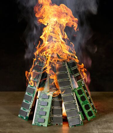 flamy: burning pile of random access memory sticks in front of dark back