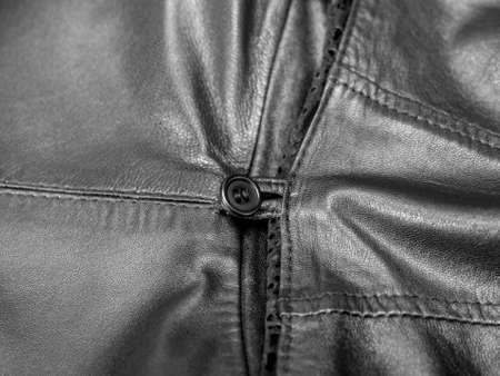 detail of a black leather coat