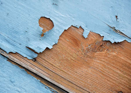 flaking: detail of blue flaking paint on wooden surface Stock Photo
