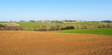 springtide: agricultural scenery including a village in Hohenlohe named Kuensbach