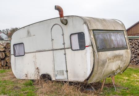 rundown: a rundown dirty old caravan