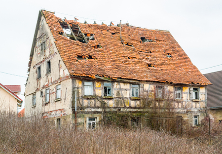 flaking: a rundown old farmhouse in Southern Germany