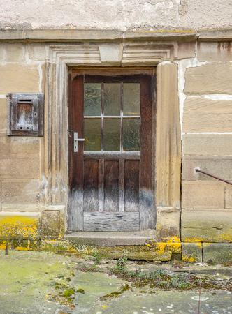 rundown: door of a rundown old farmhouse in Southern Germany