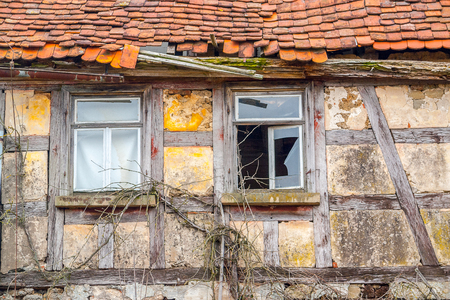 flaking: detail of a rundown old farmhouse in Southern Germany Stock Photo