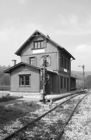 wood railroad: black and white picture of a historic railway station seen in Southern Germany