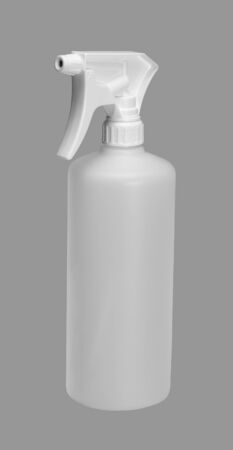 studio photography of a white spray bottle in grey back Stock Photo