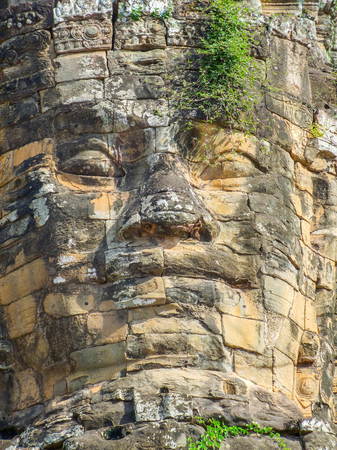 angkor thom: Temple detail at Angkor Thom showing a rock carved face Stock Photo