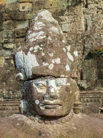 thom: Temple detail at Angkor Thom showing a rock carved face Stock Photo