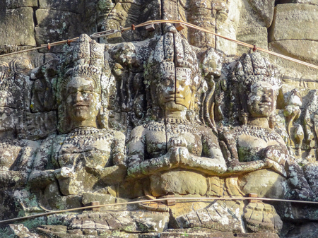 bayon: carved stone figures at Bayon Temple located at Angkor in Cambodia