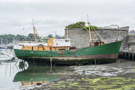 ville: old fishing boat in a town named Concarneau in the Finistere department of Brittany in France Stock Photo