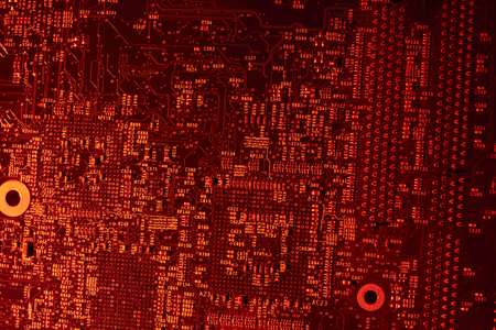 conductive: full frame red illuminated printed circuit board closeup Stock Photo