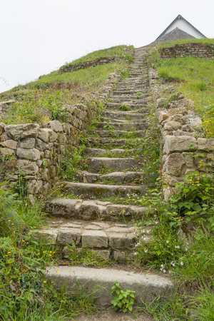 tumulus: stairway at a megalithic grave mound named Saint-Michel tumulus near Carnac, a commune in the Morbihan department of Brittany, France