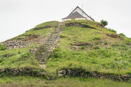 tumulus: megalithic grave mound named Saint-Michel tumulus near Carnac, a commune in the Morbihan department of Brittany, France Stock Photo