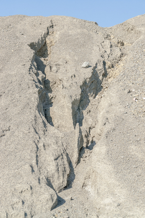 grooves: sunny gravel pile including some eroded grooves Stock Photo