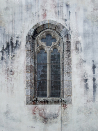commune: rundown church window at Pont-Aven, a commune in the Finistere department of Brittany in northwestern France. Stock Photo
