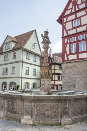 waterspout: fountain in Rothenburg ob der Tauber, a town in Middle Franconia in Bavaria, Germany