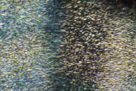 opalescent: full frame microscopic detail of a holography