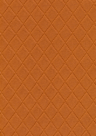 a full frame abstract stitched orange leather background Stock Photo