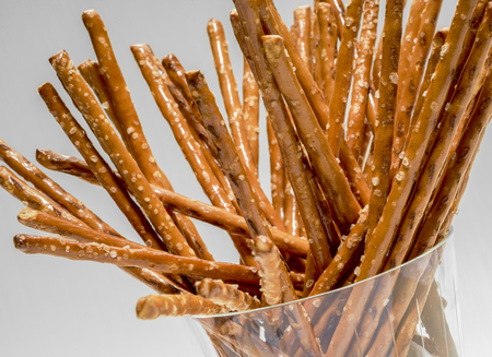 closeup of some salt sticks in a glass in grey back Stock Photo