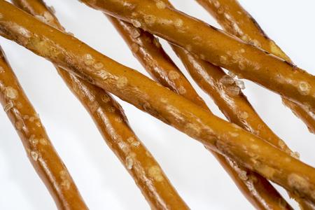 ailment: closeup of some salt sticks in light back