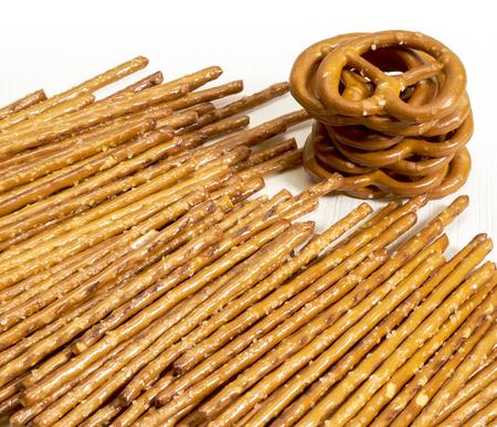 pretzel stick: closeup of some salt sticks and pretzels in light back