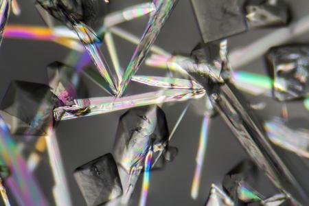 macro shot of growing microcrystals of soda lye in polarized light