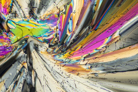 colorful micro crystals of liqueur in polarized light Stock Photo