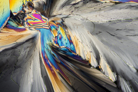polarised: colorful micro crystals of liqueur in polarized light Stock Photo