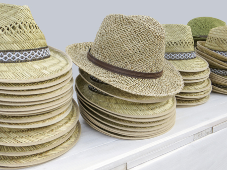 detail shot including lots of straw hats