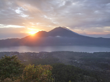 cloudy evening scenery around a volcano named Mount Batur in Bali, Indonesia