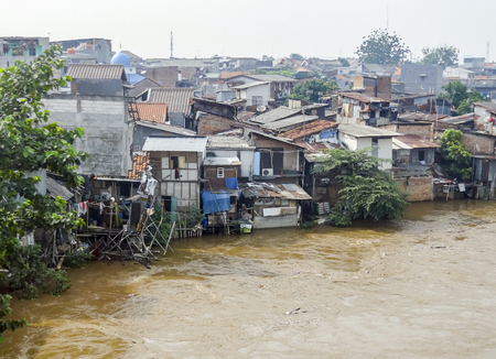 Slum scenery near at a river near Jakarta in Java, Indonesia