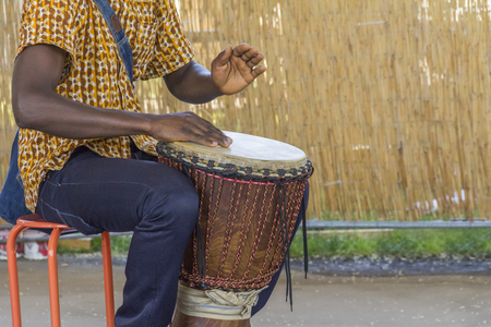 detail of a african dlembe player