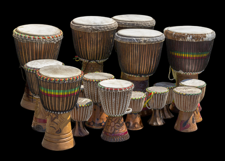 lots of african djembe drums in different sizes in black back