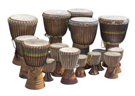 lots of african djembe drums in different sizes in white back Stock Photo