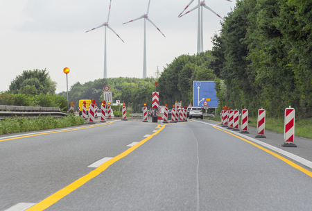 thoroughfare: road scenery on a highway including wind turbines and road works in Southern Germany Stock Photo