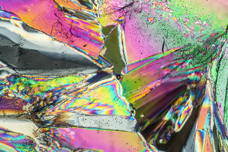 colorful microscopic shot of Trisodium citrate microcrystals in polarized light