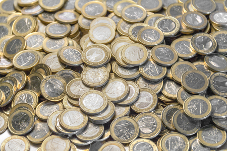 silver coins: Full frame picture showing lots of 1 euro coins